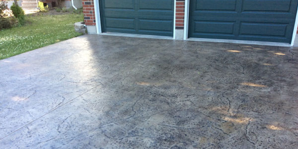 My stamped concrete by torus construction ottawa for Temperature to pour concrete driveway