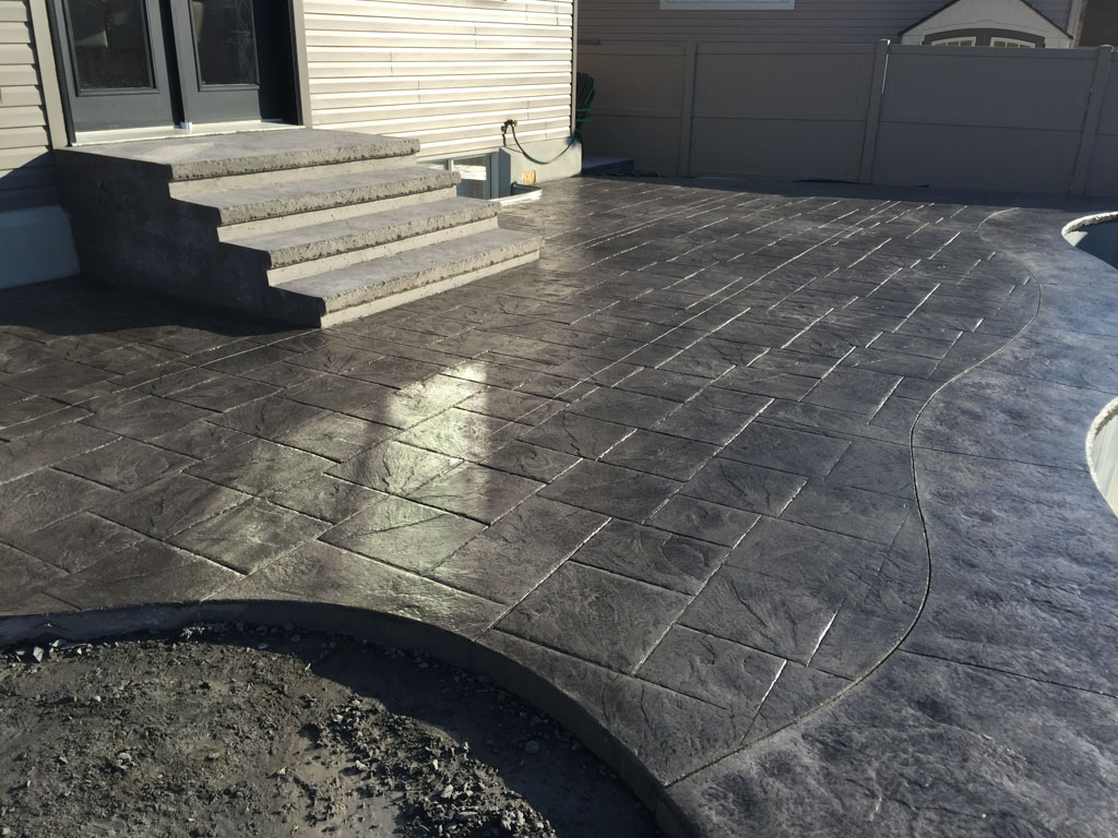 Stamped concrete patio walkway and steps